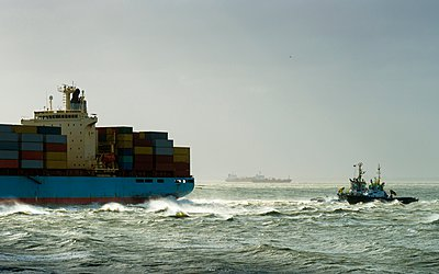 Container ship run aground with tugs rescuing, Vlissingen, Zeeland, Netherlands - p429m1029584 by Mischa Keijser