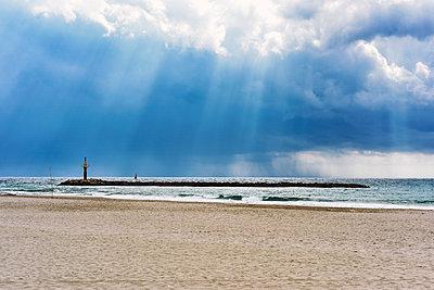 The main beach of Torredembarra, Spain, in an autumn cloudy day - p1423m2215660 by JUAN MOYANO
