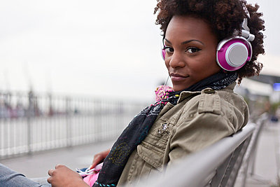 Woman listening to music - p6420228 by brophoto