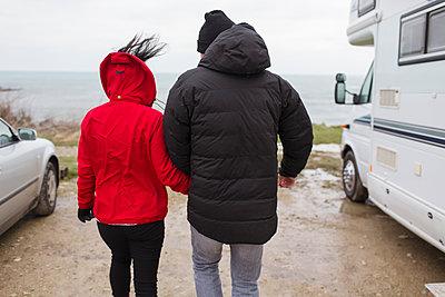 Couple walking outside motor home - p1023m2024371 by Sam Edwards