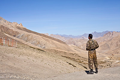 Soldier looking over the Indian border in the Himalayas - p1072m857492 by Cristina Saez