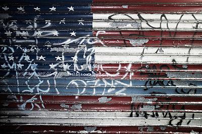 Flag on metal shutters - p301m960770f by Michael Mann