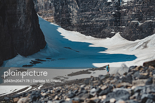 Hiker on Plain of Six Glaciers, Alberta, Canada - p343m2047178 by Daniele Molineris