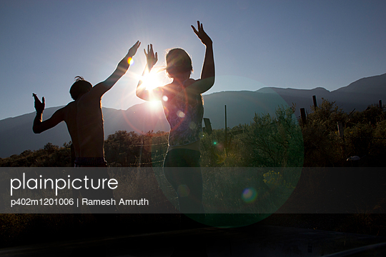 Young people dancing at sunset
