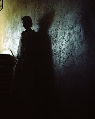 Woman on stairs - p945m2125803 by aurelia frey