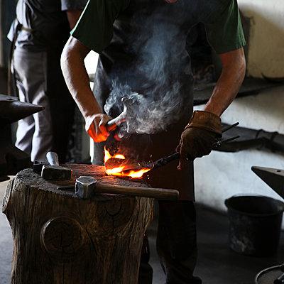 Blacksmith at work  - p1105m1461981 by Virginie Plauchut