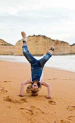head stand on the beach - p1070m1467941 by Meeke Voges