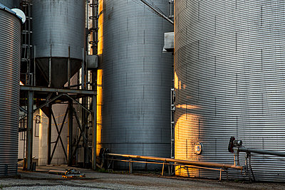 Milling silos at sunset - p1291m1362439 by Marcus Bastel