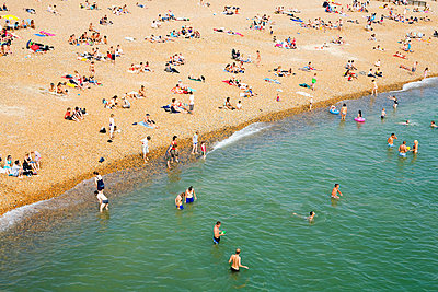 People on crowded beach - p9240243 by Image Source