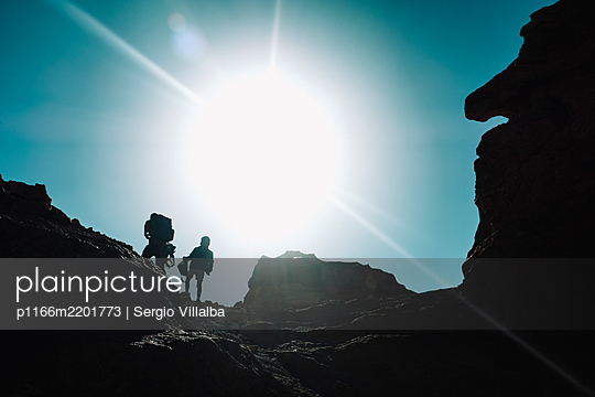 Man and boy hiking in mountains, Tenerife, Canary Islands, Spain - p1166m2201773 by Sergio Villalba