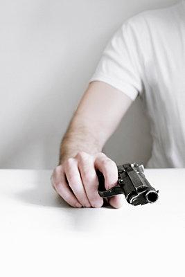 Anonymous man with a handgun - p1228m1193769 by Benjamin Harte