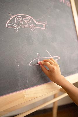 Boy drawing on blackboard - p5143214f by doable