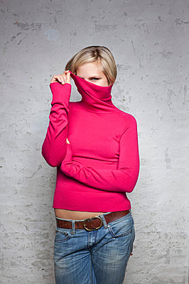 Young woman in a pink turtleneck - p6420155 by brophoto