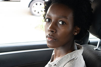 Young African woman in a car - p1640m2260072 by Holly & John
