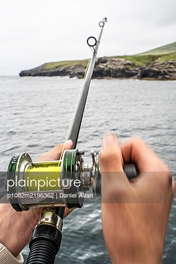 Fishing off the coast  - p1082m2196362 by Daniel Allan