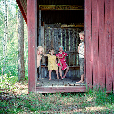 Children inside outhouse - p5282635 by Johan Willner