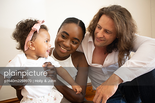 Multi ethnic family with toddler girl - p1640m2259970 by Holly & John