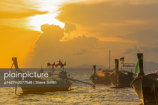 Boats at sunset in West Railay, Thailand - p1427m2077548 by Steve Smith
