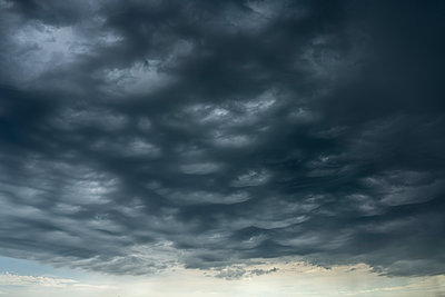 Dark clouds, dramatic sky - p1132m2291569 by Mischa Keijser