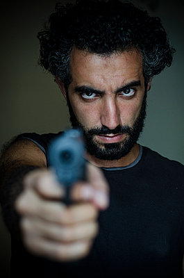 Angry man holding a gun  - p794m933272 by Mohamad Itani