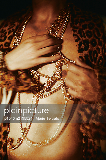 man wearing golden necklaces - p1540m2195824 by Marie Tercafs