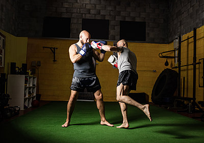 Thai boxers practicing boxing - p1315m1198937 by Wavebreak