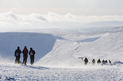 Hikers on snow covered Pen y Fan mountain, Brecon Beacons National Park, Powys, Wales, United Kingdom, Europe - p871m1073611f by Christian Kober