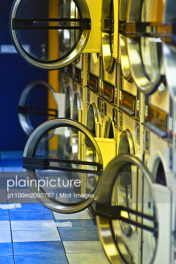 Washers and Dryers in Public Laundromat - p1100m2090797 by Mint Images