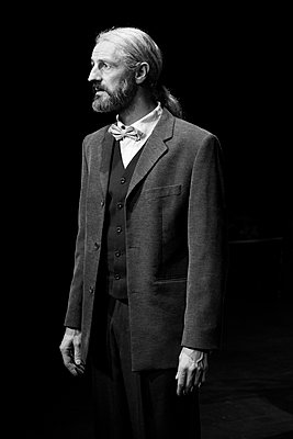 Portrait of Bearded Man in Suit with Long Hair in Ponytail - p694m1045772 by Julio Calvo