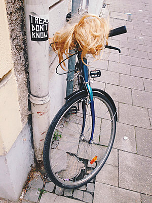 Wig on a bike, Fasching, Munich, Bavaria, Germany - p300m1009192f by Gerald Staufer