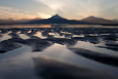 Close-up of the ripples and tide pools on the shores of the tidal flats at sunset; Homer, Alaska, United States of America - p442m1482912 by Scott Dickerson