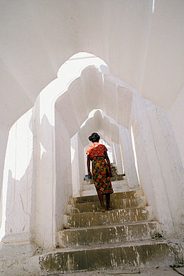 Woman Climbing Up Stairs - p644m727618 by Jenny Acheson