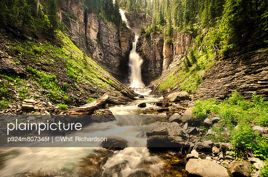 Blurred view of waterfall in canyon - p924m807345f by ©Whit Richardson