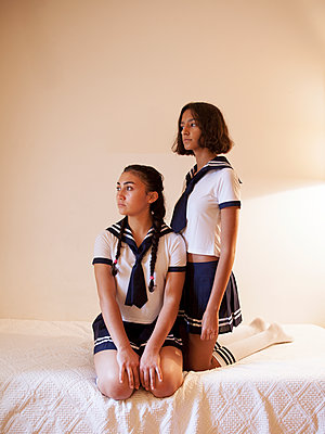 Two girls wearing sailor suit - p1105m2128794 by Virginie Plauchut