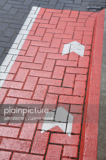Road markings on a cobblestone road - p30120070f by Vladimir Godnik