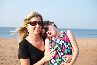 Mother and Daughter on beach - p1169m1124071 by Tytia Habing