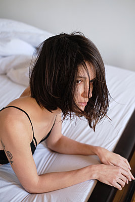 Young brunette woman woke up in her bed at morning - p1607m2183914 by zhushman