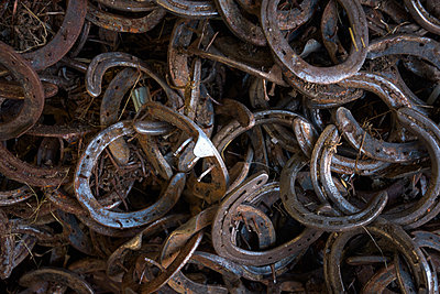 Full frame image of horseshoes - p429m1408232 by Tommy Martin