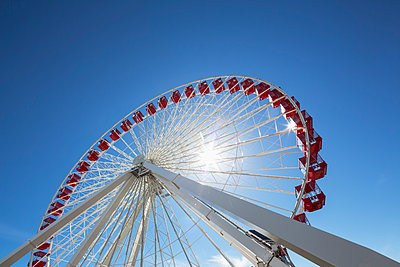 Ferris wheel against blue sky - p300m975158f by Fotofeeling