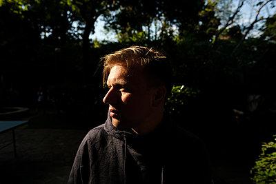 Portrait of man in shady park - p1363m2164021 by Valery Skurydin