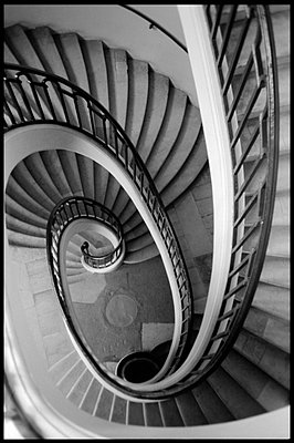 Elaborate spiral staircase winding to ground floor - p3720282 by James Godman