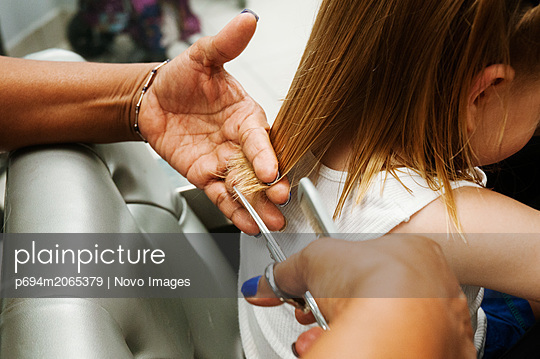 Young Boy with Long Hair Getting Haircut - p694m2065379 by Novo Images