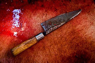 A fishmonger's bloody knife in Tsukiji Market, Tokyo, Japan. - p934m1177222 by Dominic Blewett