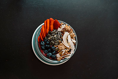 Super food fruit and nuts healthy bowl on table - p1166m2106298 by Cavan Images