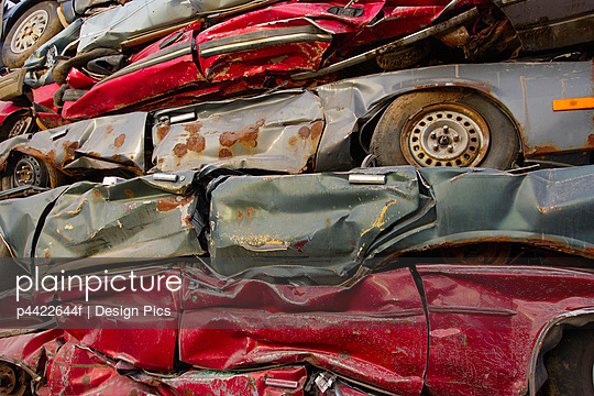 Crushed cars - p4422644f by Design Pics