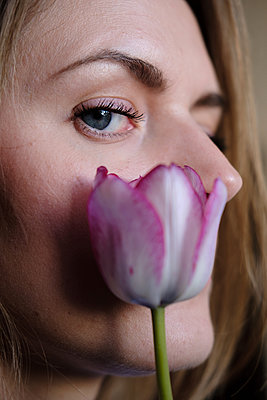 Woman with a tulip flower - p1363m2065205 by Valery Skurydin