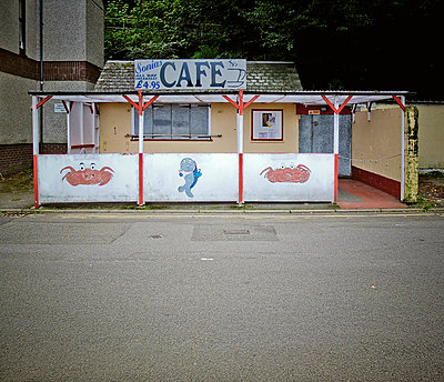 Rundown seaside cafe - p1072m829243 by Neville Mountford-Hoare