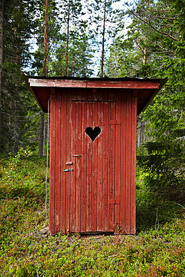 Outhouse in forest - p528m742241f by Sara Danielsson