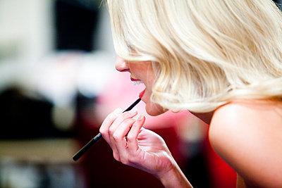 Woman Applying Lipstick - p6692418 by Kelly Davidson