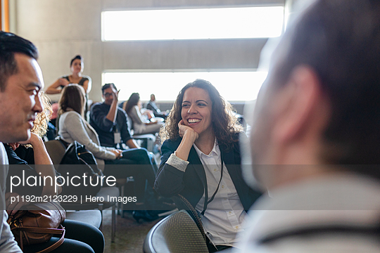 Business people talking in conference audience - p1192m2123229 by Hero Images